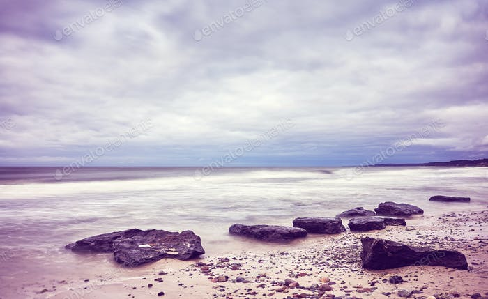 Scenic beach picture, motion blurred water.