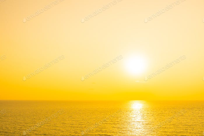 Beautiful tropical beach sea ocean with cloud and sky at sunset or sunrise time