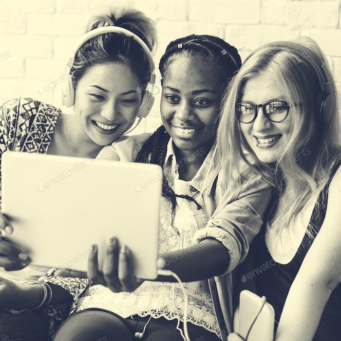 Women Friends Using Digital Tablet Concept