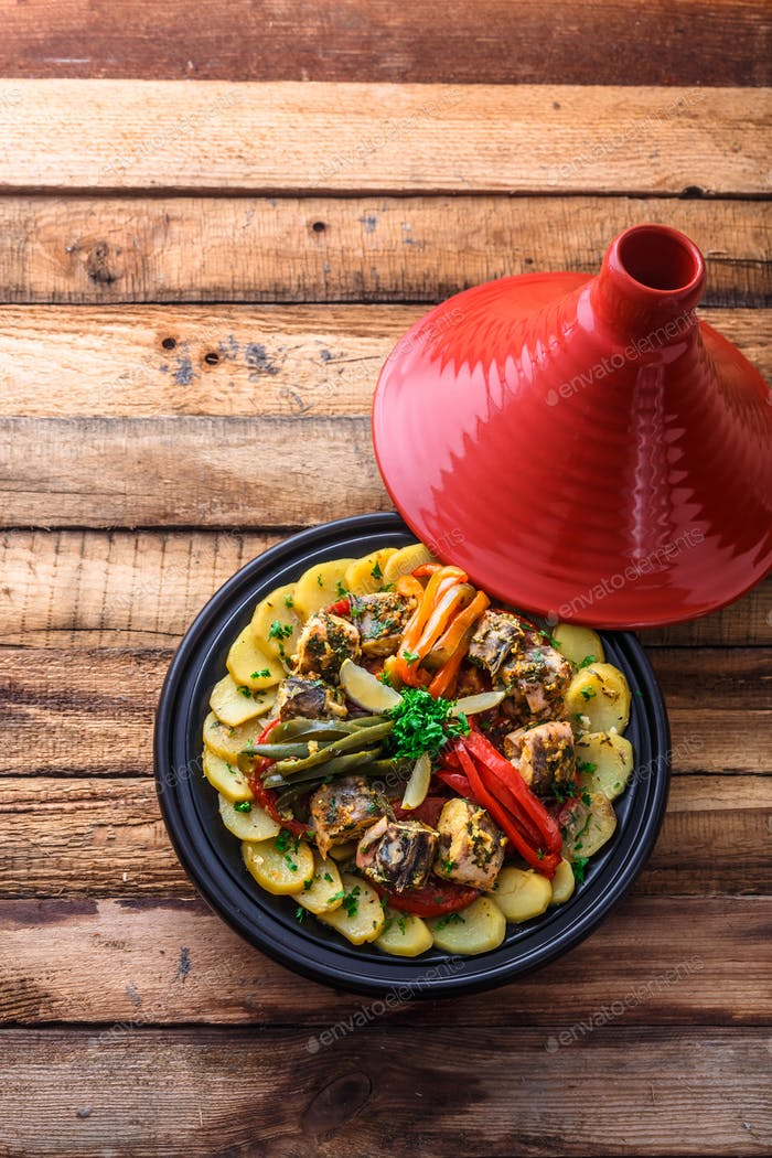 Fish tagine with chermoula, moroccan cuisine copy space