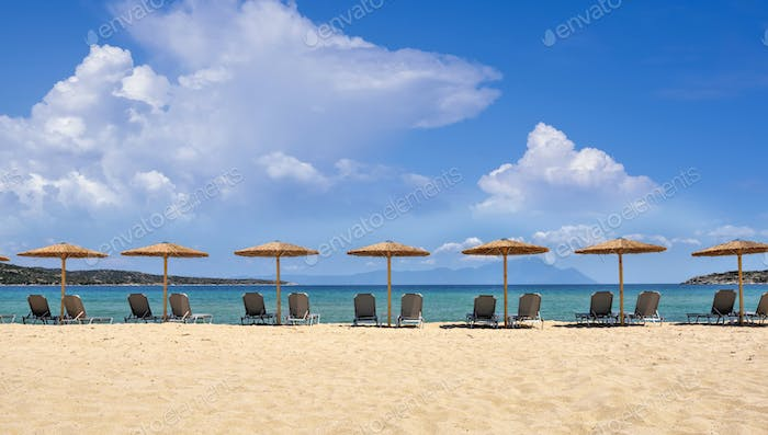 Umbrellas and chairs on the sandy beach. Sea view from beach