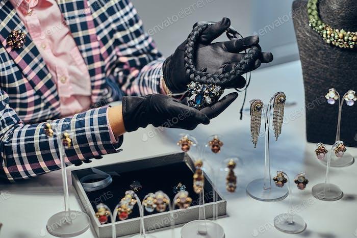 Woman seller in a luxury jewelry store.