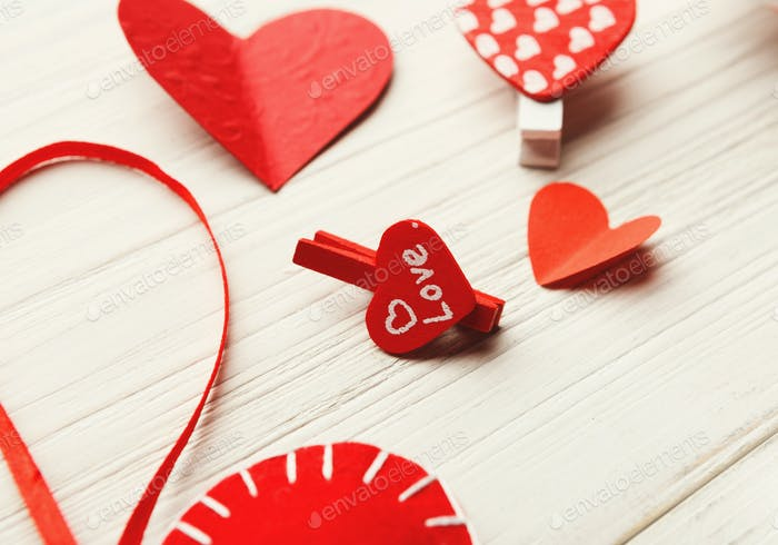 Valentine day background, handmade hearts on wood with copy space