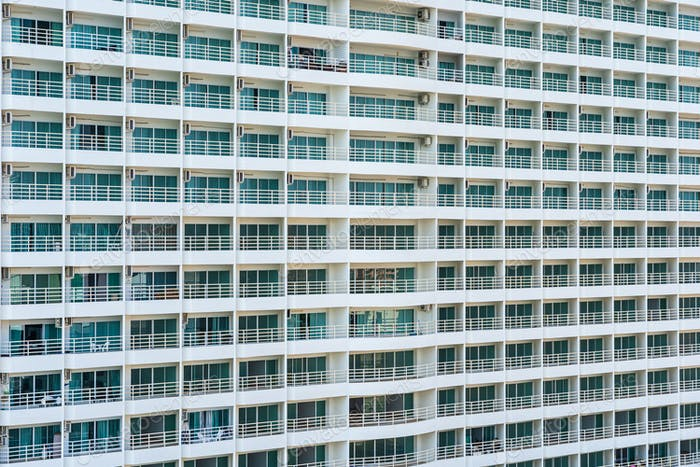 Abstract exterior building architecture and balcony with window pattern