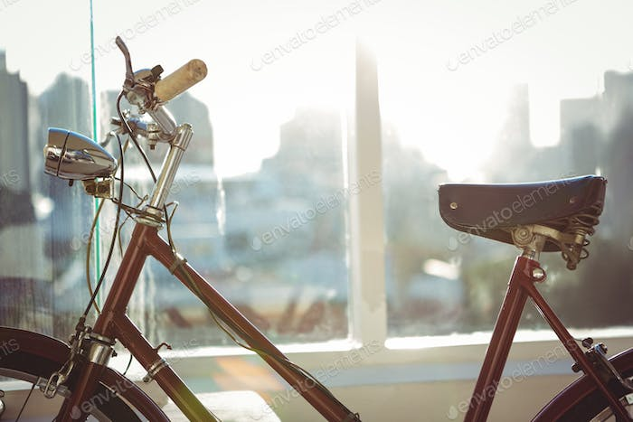 Close up view of a red bicycle in a bright room