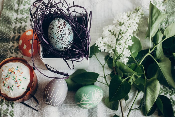 happy easter. easter egg in nest with floral and chick ornaments