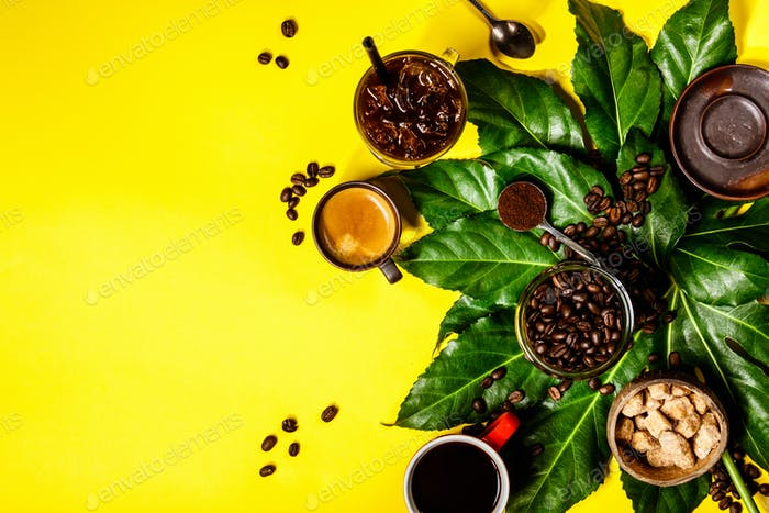 Various coffee on yellow background, flat lay