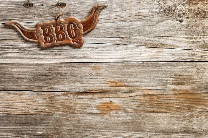bbq sign hung on a wooden wall