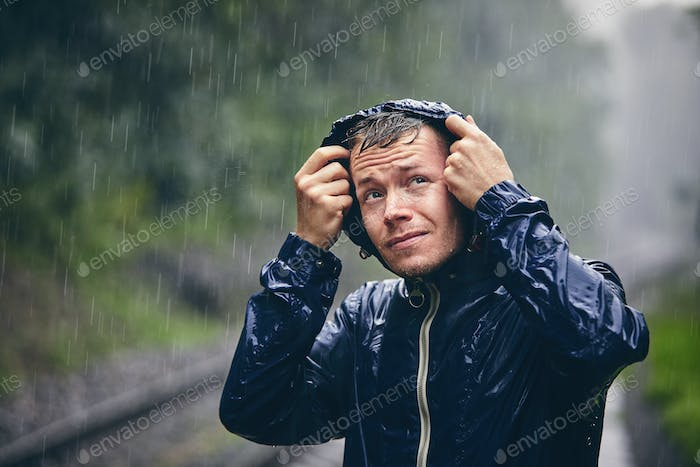Traveler in heavy rain