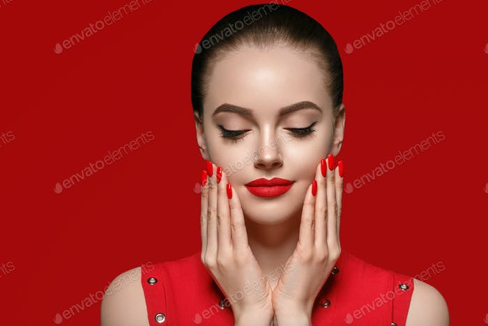 Beautiful curle hair female in red with red lips and dress manicure, beauty rose afro