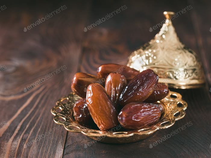 Plate of pitted dates on table