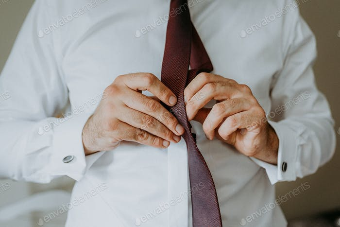 Putting on the tie