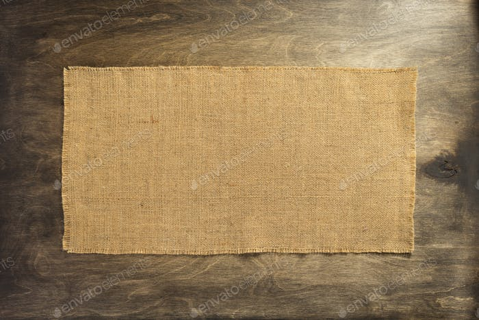 burlap hessian on wooden background