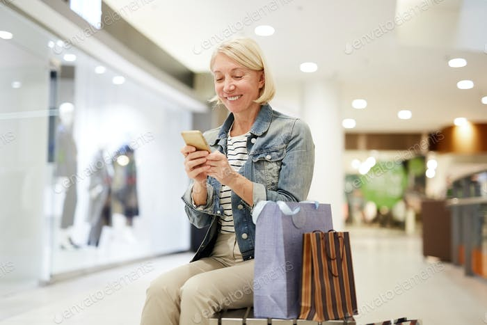 Happy woman making post about shopping on social media