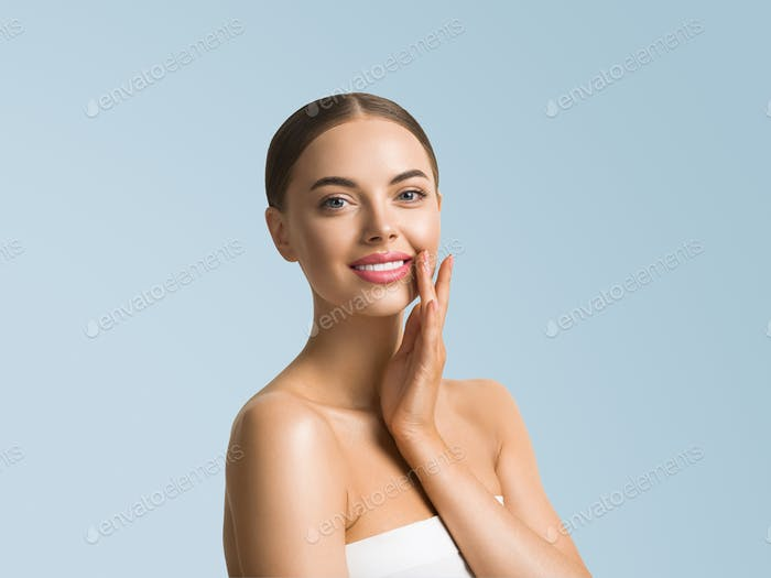 Beauty woman skin care beautiful female hand touching face cosmetic girl model over blue background