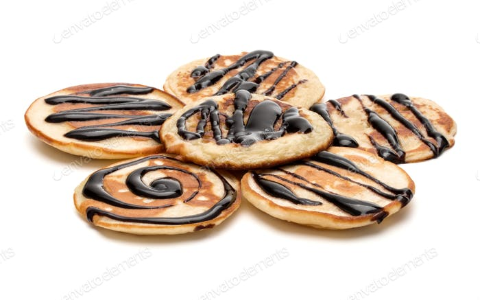 pancakes with chocolate syrup isolated on white background cutout.