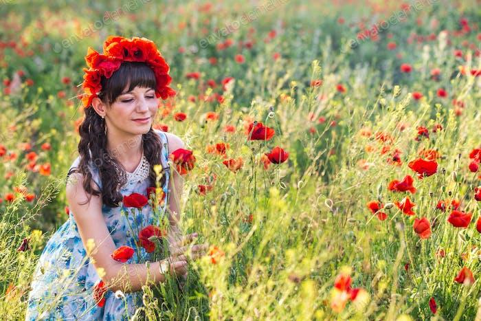 Beautiful lady on the poppy field.