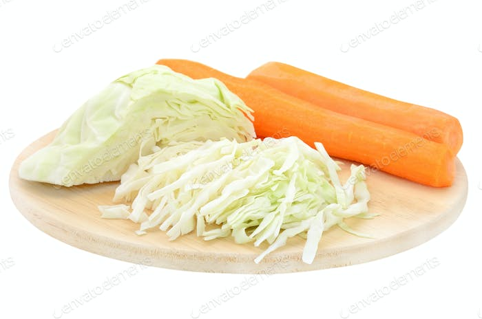 Cabbage and carrots on a cutting board