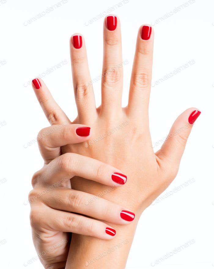 Closeup photo of a female hands with red nails
