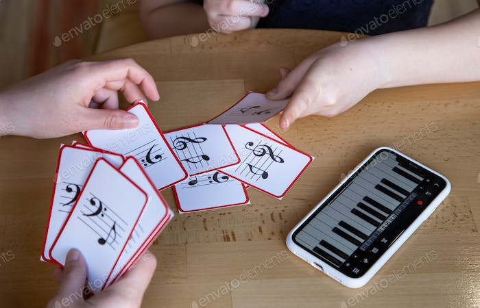 Close-up of cards for studying music and piano in the phone.