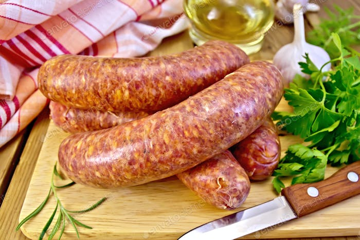 Sausages beef on board with knife