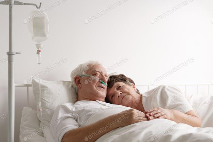 Lying next to sick husband