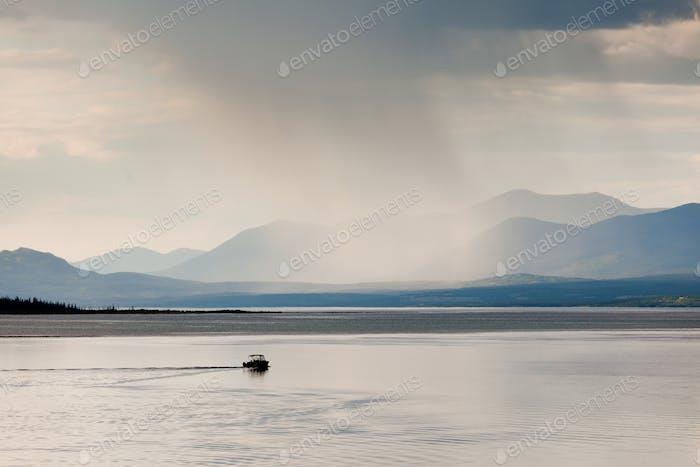 Rain shower over Marsh Lake Yukon Territory Canda