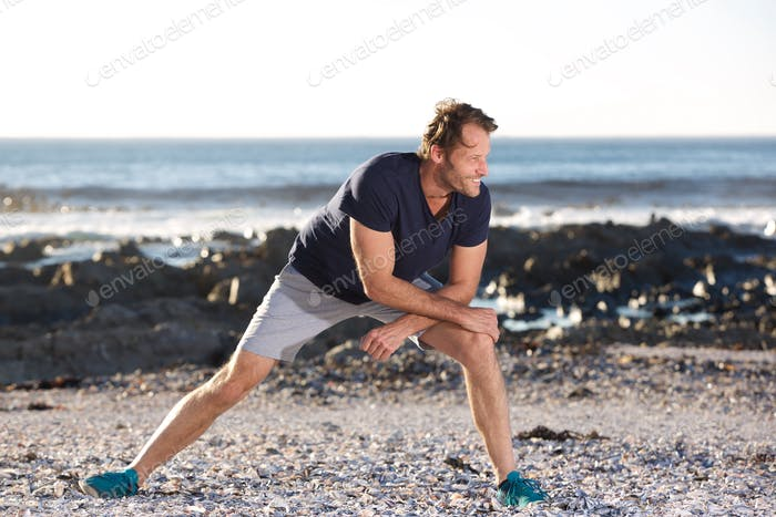 sports man stretching outside