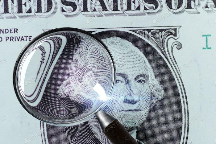 1 US Dollar under magnifying glass