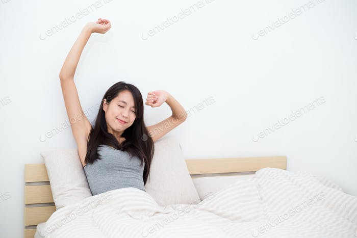 Woman doing stretching after just wake up