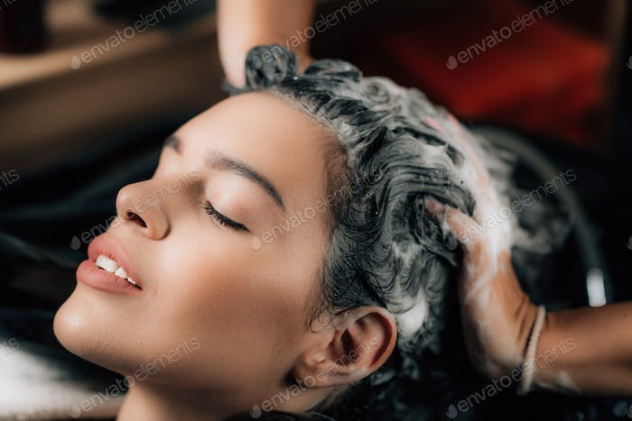 Hairdresser Washing Hair