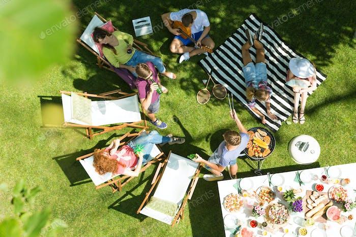 Friends having grill in garden