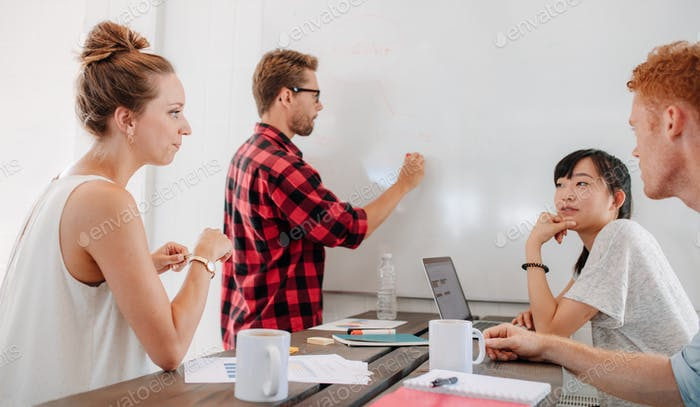 Casual young business man making presentation at startup