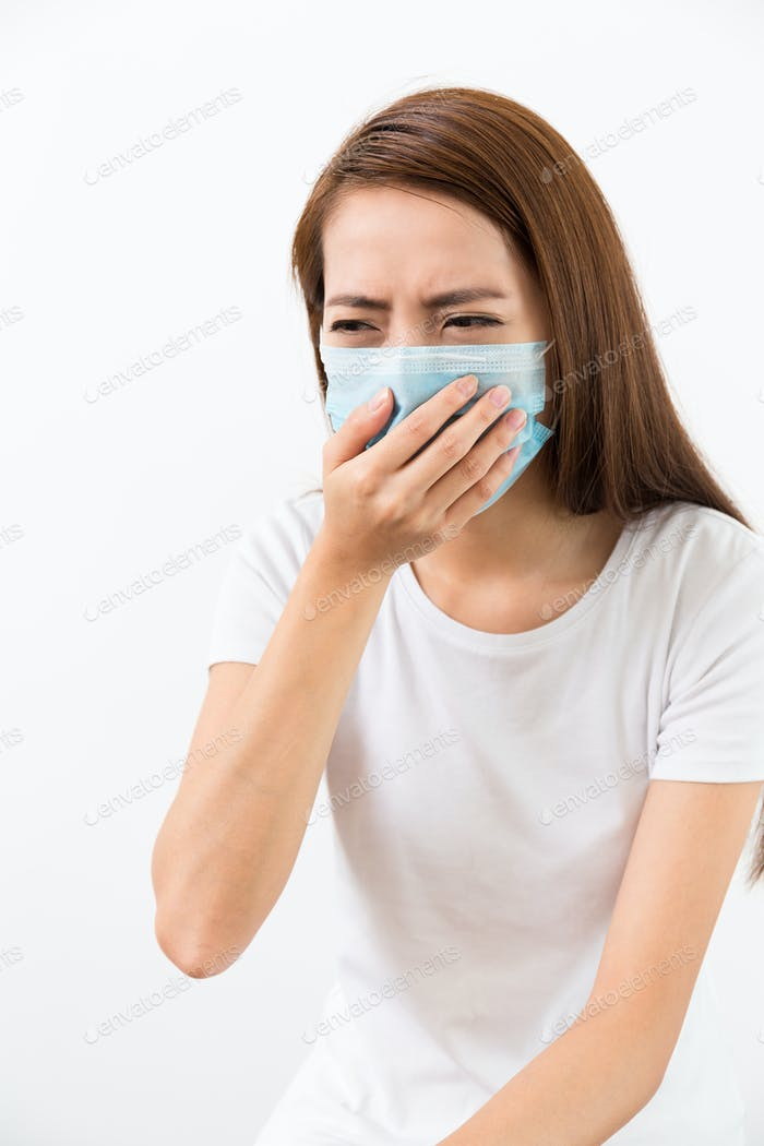 Young woman feeling unwell and wearing the mask