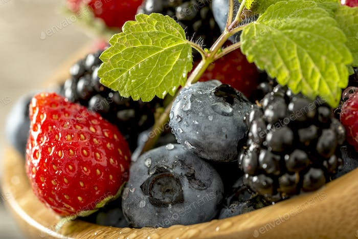 Strawberries, blackberries and blueberries close up