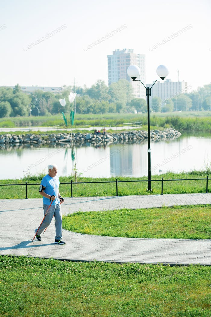 Pensioner Practicing Nordic Walking