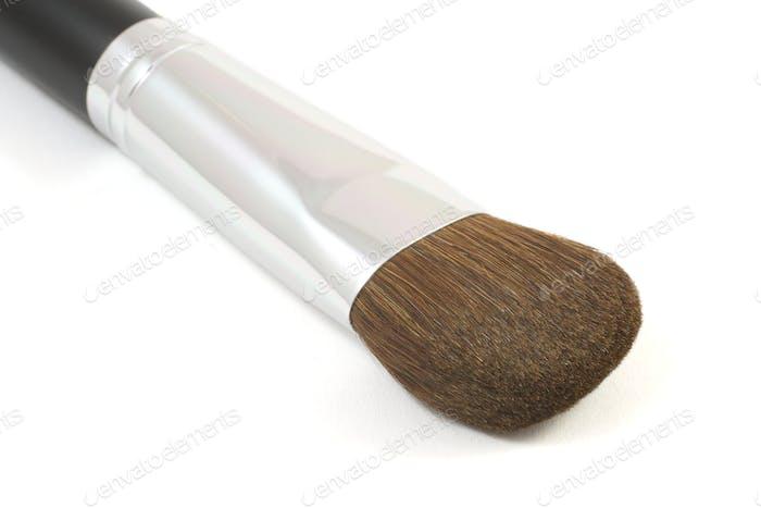 Makeup powder brush isolated on white background