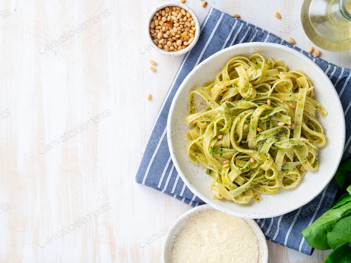 Tagliatelle pasta with pesto sauce made of Basil, garlic, pine nuts, olive oil