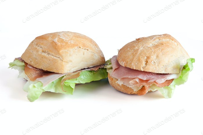 two ham and lettuce sandwhiches