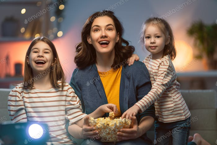 Mother and daughters spending time together.