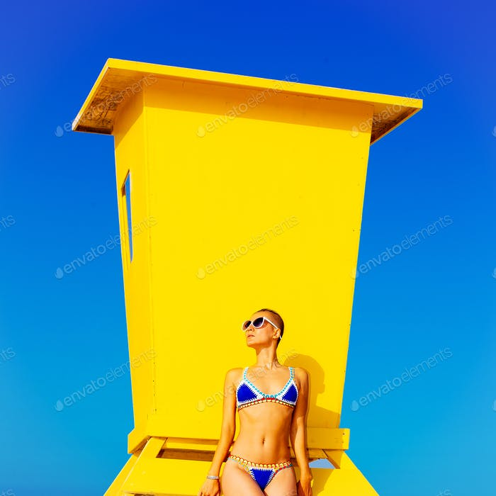 Model Beach style. Tanned body. Swimsuit fashion
