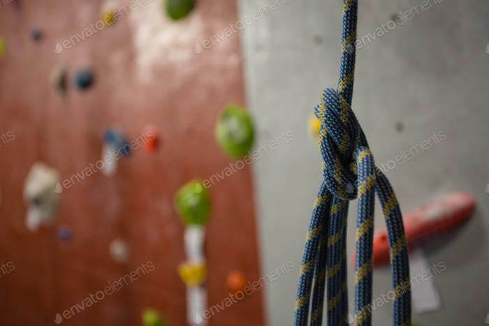 Close up of rope against climbing wall at gym