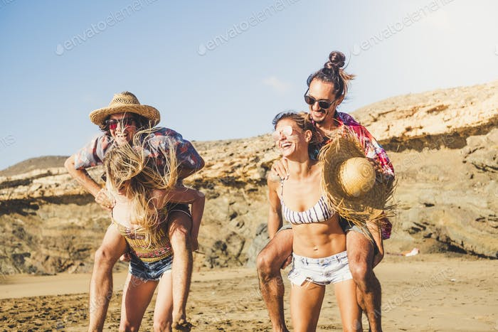 Group of happy and cheerful beautiful young people play outdoor