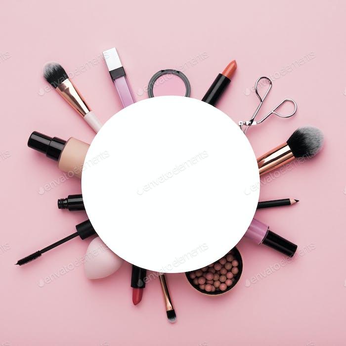 Natural makeup cosmetics around white blank sheet of paper