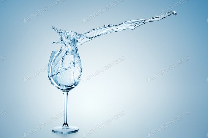 Water Splash in Wine Glass.