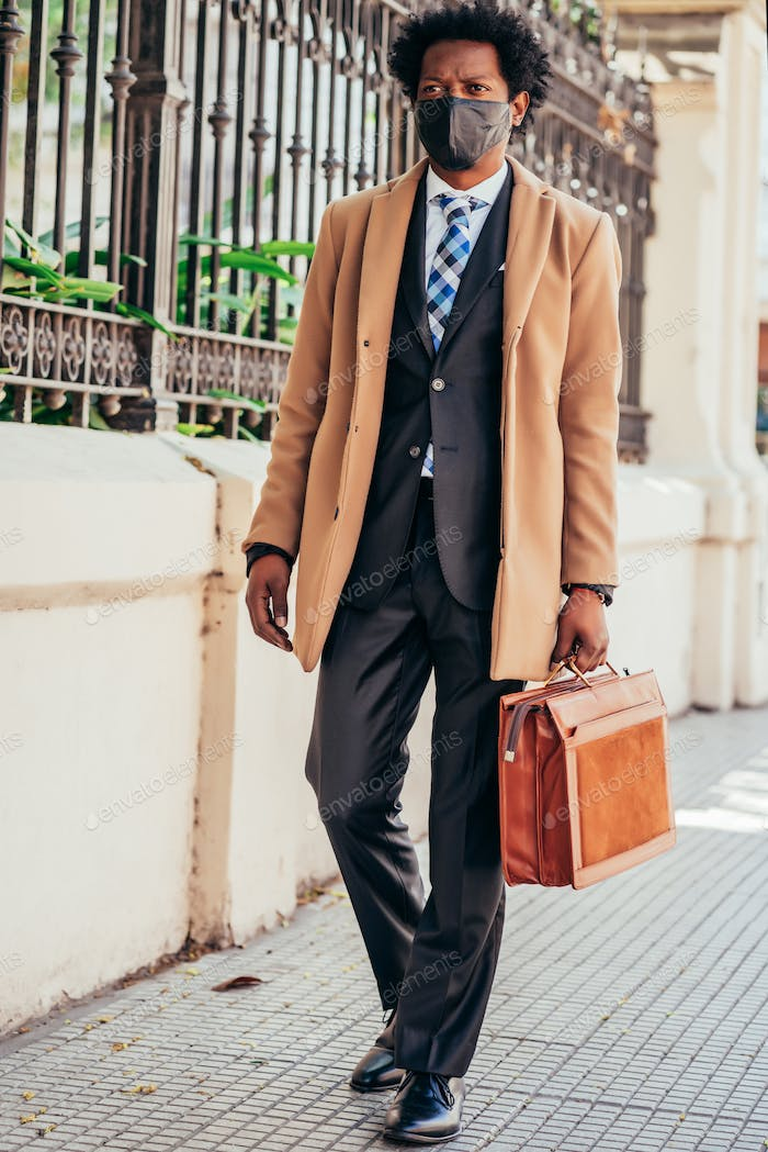 Businessman holding a briefcase.