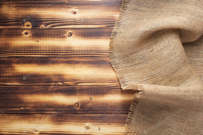 burlap hessian sacking texture on wooden background