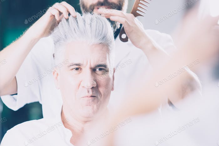 Confident man at hairdresser