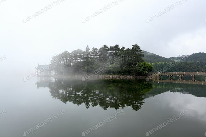 mist and a pavilion in small island