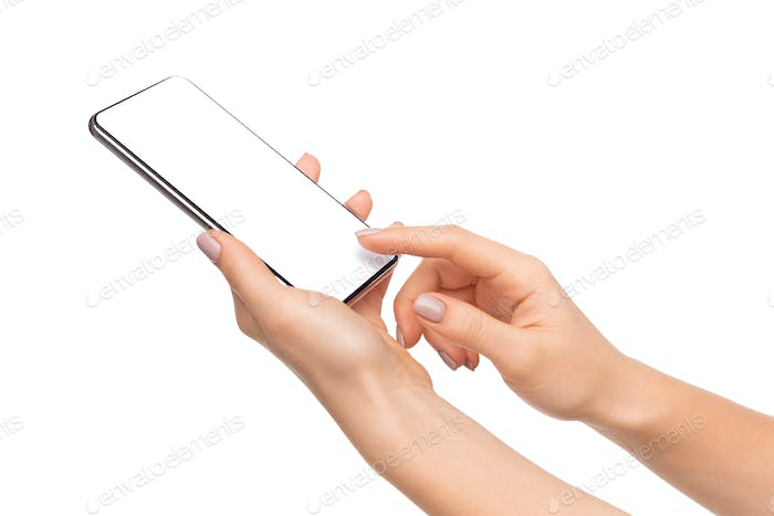Female hands using smartphone with blank screen isolated on white